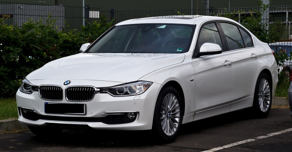 White 2012 BMW 320d in parking lot